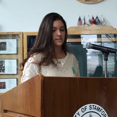 Westhill High School Senior Ariana Venneri speaks during a Mental Health Awareness Month event Monday.