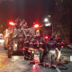 Yonkers firefighters struggled to get hoses hooked up in icy conditions.