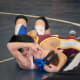 Nicky Singer of the Norwalk Mad Bulls pins his opponent.
