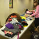 Westchester Day School students sort clothes donated as part of the clothing drive for Kid's Kloset in White Plains.
