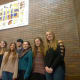 Briarcliff High School art students show off their new mural.