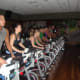 Members participate in a demonstration of the spin classes offered at Life Time Fitness.