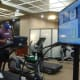 A Life Time members runs on the treadmill attached to a computer that tells him his heart rate, speed and run time.