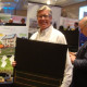 Michael Murphy of Murphy Brothers Contracting shows off a solar panel at the Westchester Business Expo in Rye Brook.