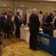 Crowds of businesspeople mingle and network at the Westchester Business Expo at the Hilton Westchester in Rye Brook.