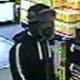 Surveillance camera captured view of theft suspect.