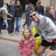 Hartsdale's Brian Wilanyowicz with his daughter at last year's Boston Marathon just before the two bombs exploded.