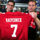 Mark Bisanzo, left, owner of Bruce Park Sports, and Nick Chapar, assistant manager, hold a Colin Kaepernick jersey. Bisanzo said he will wait to see if gay NFL rookie Michael Sam makes his team before deciding whether he will stock the jersey.