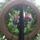 Stamford Police Assistant Chief James Matheny, at left, and Officer Ryan McAllister, at right, scene through a wreath placed in memory of Stamford Police officers who died while on duty.