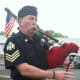 """William Sullivan of the Westchester Firefighters Pipe and Drums plays """"Amazing Grace"""" during an annual police memorial for Stamford police officers who died while on duty."""