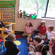 "Chapel School third-grader Charlie and ""Principal for a Day"" reads to classmates."