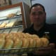 Salvador Carrera, manager of the Donut Delight location at 274 Hope St., holds up a tray of honey dip doughnuts on National Donut Day.