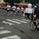 Darien Police officers run through Darien as the Law Enforcement Torch Run for Special Olympics Friday morning. The Connecticut Special Olympics began Friday in New Haven.