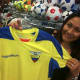 Mayria Tepan, of Port Chester, N.Y., holds the jersey of Ecuador, her native country, while in Soccer Land in Stamford on Wednesday. The World Cup begins Thursday, and Ecuador is one of the countries taking part.