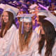 Smiling members of John Jay High School's Class of 2014 at their commencement.