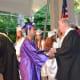 A John Jay High School 2014 graduate receives his diploma.