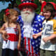 Reagan Godfrey and Joe Warren as Uncle Sam, and Jack McKeever feeling patriotic at the 2013 Push-n-Pull Parade.