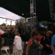 The audience scrambles for cover as rain comes down during the Bacon Brothers performance at Jazz Up July on Wednesday at Columbus Park in Stamford. The show resumed after a 15-minute break.