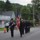 Danbury firefighters march in the Brewster parade.