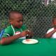 Brothers Jayne, 6, and Derwin Preux, 7, check out yellow beans at Fairgate Farm's Farm to Table workshop.