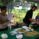 Alexandra Garces, a nutrionist, displays a recipe to a group of about a dozen people at the Farm to Table workshop at Fairgate Farm.