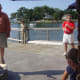 Event organizer Frank Kemp addresses volunteer captains and crew members before casting off Friday.