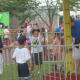 One young man tests his strength at the Easton Fireman's Carnival.