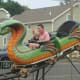 A miniature roller coaster rides the rails at the Easton Fireman's Carnival.