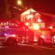 Norwalk firefighters on the scene at a fire on Larsen Street on Monday night.