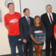 Brenda Moratoya, center, of Stamford is honored Wednesday for saving the life of a teenager in a near drowning on Aug. 6. From left is lifeguard Richard Glass, U.S. Sen. Richard Blumenthal, Mayor David Martin and lifeguard Leann Moy.