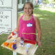 Noelle DeFelice displays the miniature circus she made at the workshop at the Westport Historical Society.