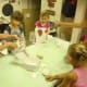 The kids at the Westport Historical Society make art projects on the last day of the circus workshop.