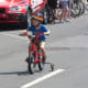 A young racer at the Danbury Audi Race4Scholars Criterium amateur and professional races. It was held on a 1-kilometer course in the city.