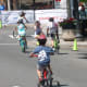 Young racers take the first corner at the Danbury Audi Race4Scholars Criterium amateur and professional races. It was held on a 1-kilometer course in the city.