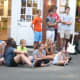 Music lovers listening during a group's performance at the Taste of the Town Stroll Thursday in New Canaan.