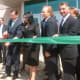 Gov. Dannel P. Malloy cuts the ribbon at the reopened J.M. Wright Technical High School on Wednesday.