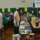 Redding readers fill up bags with books of all genres at the book fair.
