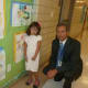 Julia A. Stark School first grade student Zoe Guaman looks at some artwork on the wall along with her principal Mark Bonasera on the first day for Stamford Public Schools on Tuesday.