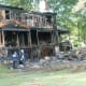 A home at 25 Bittersweet Lane in North Stamford was destroyed by an early morning fire Wednesday. The three occupants escaped. The cause is under investigation.