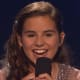 "Mamaroneck's Carly Rose Sonenclar, smiling after a performance on ""X Factor."" She received the second-most viewer votes Thursday night."