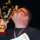 Bruno di Fabio kisses his trophy after winning the Pizza World Championship in Paris.