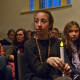 Lulu Busk, 13, her sister Bella, 10 and their mother, Andrea, sit with candles at the Westport memorial service Sunday evening to remember the victims of the Sandy Hook Elementary School shooting.