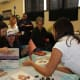 New members of the JLCW in Scarsdale work on creative picture frames during the event.