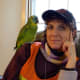 Pound Ridge artist Donna Simons poses in her emergency vest with her parrot Sweet Pea at the Town House after Hurricane Sandy.