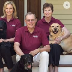 Jennifer Hill (left), president and CEO of Canine Company, with her parents, Henry and Carol Hill, who founded the company 30 years ago, along with a few of the family's pets.