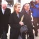 Kerry Kennedy exits the Westchester County Courthouse in White Plains with her lawyers following the first day of her trial Monday.