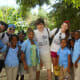 Four Staples High School students (l-r: Nick Moro-senior; Jimmy Ray Stagg- sophomore; Eli Debenham- freshman; Ale Benjamin-junior) take a break from work to spend time with children in the community of La Berma in the Dominican Republic.