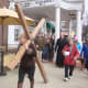 Members of several Darien churches carry a large wooden cross through the downtown area to commemorate Good Friday.