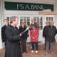 The Rev. Christopher Leighton reads a prayer for artists outside the Darien Playhouse on Good Friday.