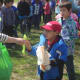 Wolfpit students line up to receive seedlings provided by Stew Leonard's following the Arbor Day celebration.